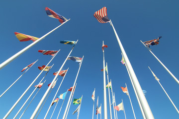 world nations flags in the wind with blue sky background