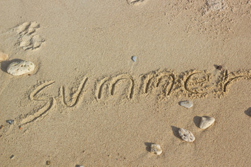 """summer"" handwritten on sand, summer background, sea and sand ba"