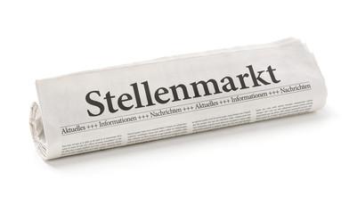 Zeitungsrolle mit der Überschrift Stellenmarkt