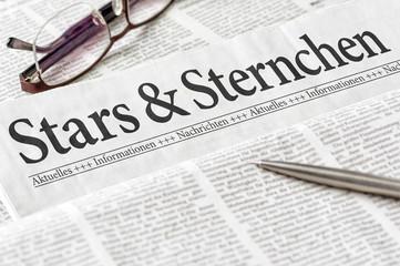 Zeitung mit der Überschrift Stars und Sternchen