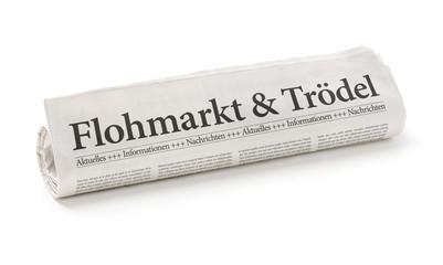 Zeitungsrolle mit der Überschrift Flohmarkt und Trödel