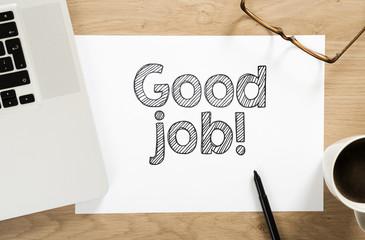 """good job"" written paper on the office desk"