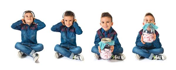 Kid listening music over white background