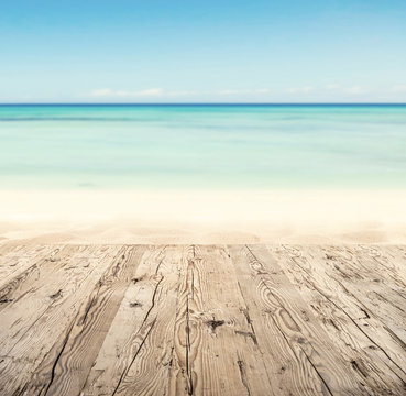 Empty wooden pier with view on sandy beach