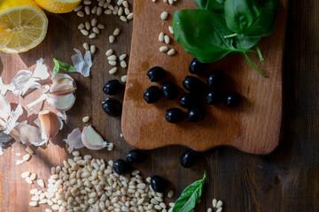pesto preparation ingredients basil, garlic, lemon, pine, olives