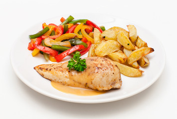 Hähnchenbrust mit Röstkartoffeln und Paprikagemüse