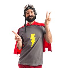 Superhero doing victory gesture