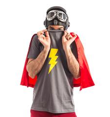 Superhero hiding behind his shirt