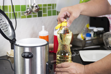 Chef open cap of vegetable oil bottle