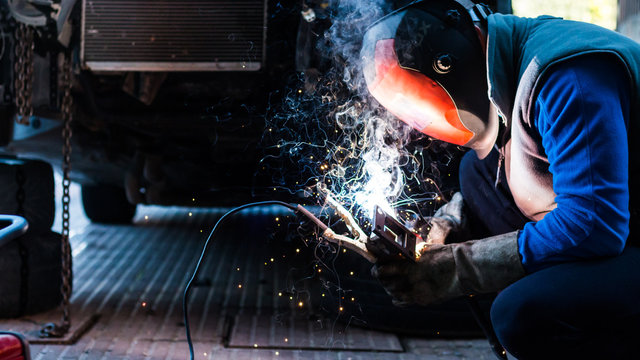 skilled mechanic welding some custom parts of his car.