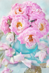 Arrangement with fresh pink roses on a table.