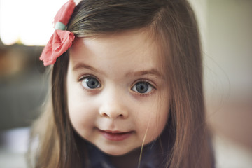 Portrait of cute little girl with big eyes