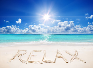Wall Mural - written relax on sand of the tropical beach with sun