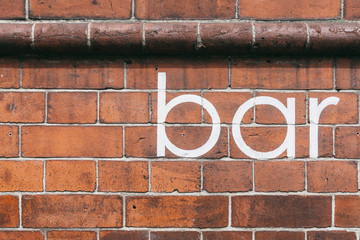 Bar Lettering on a Brick Wall