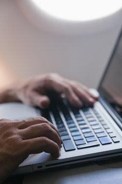 Man Using a Laptop During a Flight
