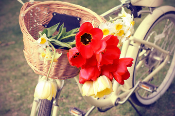 Retro photo -- Bike with flowers in a basket