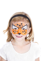 Young girl wearing cheetah carnival face paint