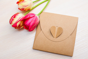 Tulips and boxes with gift on a white background