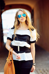 Young beautiful girl with bag and sunglasses