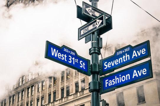 Modern street signs and urban vapor steam in New York City
