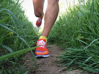 Closeup of runner on grassy path