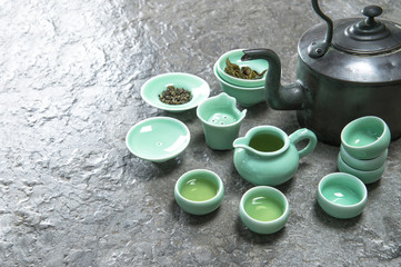Tableware for traditional asian tea ceremony. Teapot nad cups