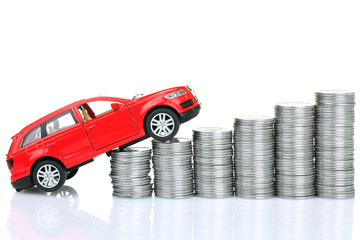 coins and sports red car blur in background isolated