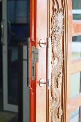 opened wooden door with modern handle