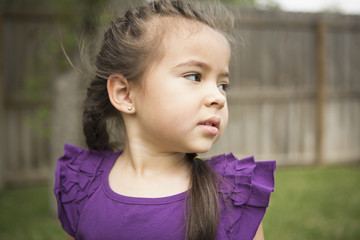 A young girl looking over her shoulder.