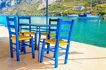 Foto op Aluminium Poolcirkel Wooden chairs in classic Greek resturant, Greece