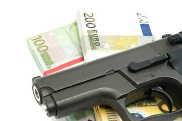 gun and banknotes