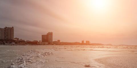 Vladivostok cityscape, day. Winter. with sunshine effect.