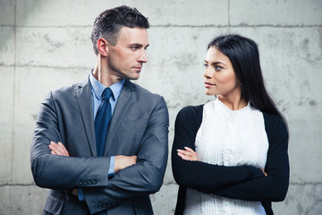 Businessman and businesswoman looking at each other