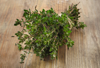 Thyme on  rustic wooden table.