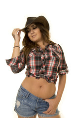 cowgirl with tattoos and hat low view
