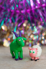 Plasticine world - little homemade green goat with purple horns