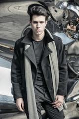 Young Handsome Man in Black Coat Standing in City