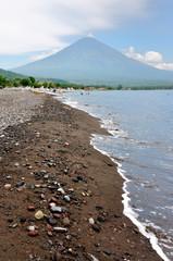 The black sand beach, Amed beach with the valcano Agung