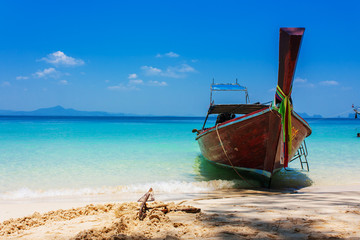 Boat on the beach and blue sky in Thaniland