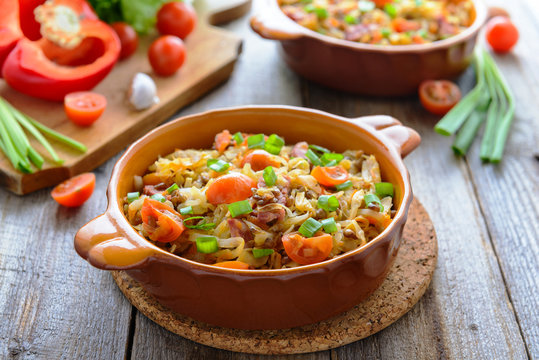 Stewed cabbage with tomatoes, onions and sausages