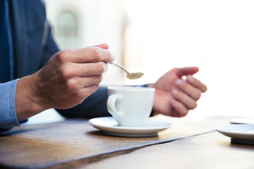 Businessman`s hands with coffee
