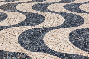 Typical portuguese cobblestone hand-made pavement calçada in Li
