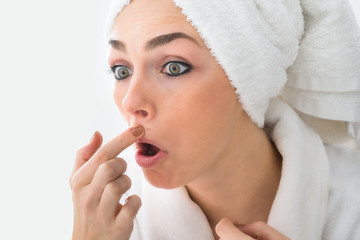 Shocked Woman Looking At Pimple On Face