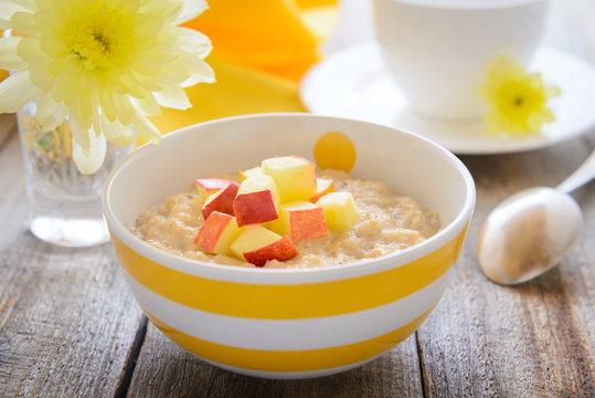 Healthy breakfast - oatmeal porridge with slice of apples