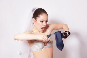 Wicked bride scissor a groom tie