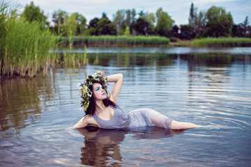 Beautiful drowned woman lying in the water