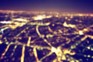 Big city night lights bokeh, blurred background. Vintage