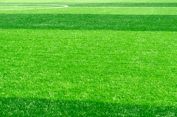 white stripe on artificial green grass of soccer field