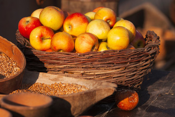 Apple and corn in basket on market