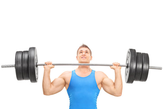 Male weightlifting athlete lifting a heavy weight